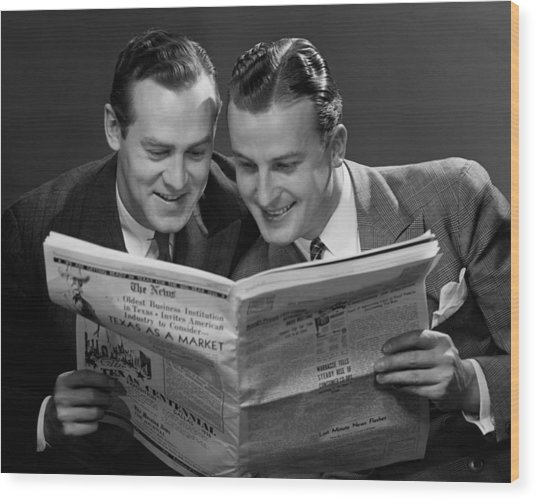 Two Businessmen Reading Newspaper Wood Print by George Marks
