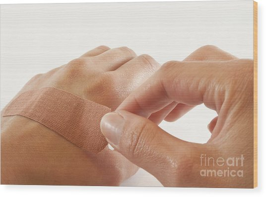 Two Hands With Bandage Wood Print by Blink Images