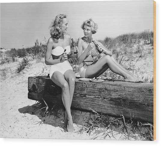 Two Women Drinking Soda On Beach Wood Print by George Marks