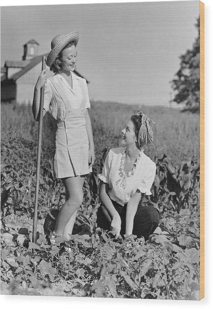 Two Women Gardening In Field Wood Print by George Marks