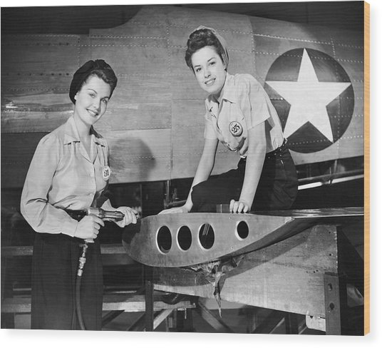 Two Women Working On Airplane Wood Print by George Marks