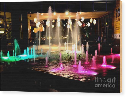 Water Fountain With Stars And Blue Green With Pink Lights Wood Print