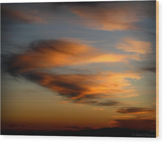 Wind Blown Sunset Sunset Clouds Over Mount Taylor Wood Print by Aaron Burrows
