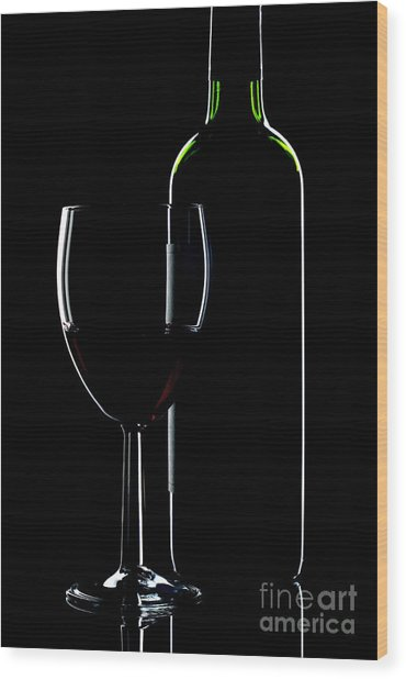 Wine Bottle And Glass Wood Print by Richard Thomas