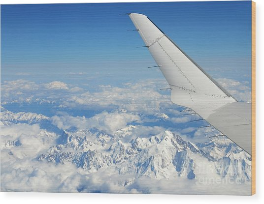 Wings Of Flying Airplane Over French Alps Wood Print by Sami Sarkis