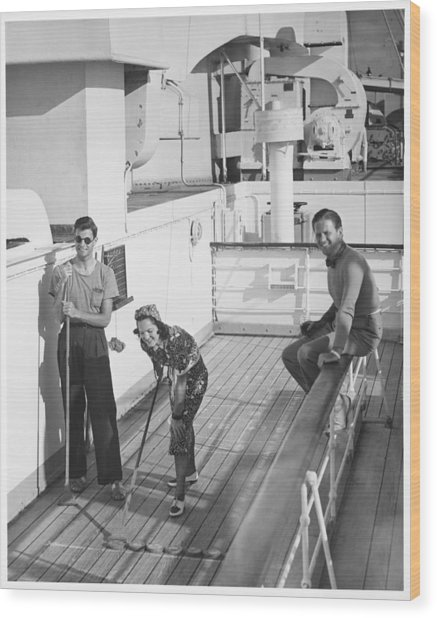 Woman And Two Men On Cruiser Deck, (b&w), Elevated View Wood Print by George Marks