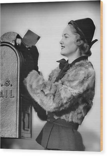 Woman Dropping Letter Into Mailbox Wood Print by George Marks