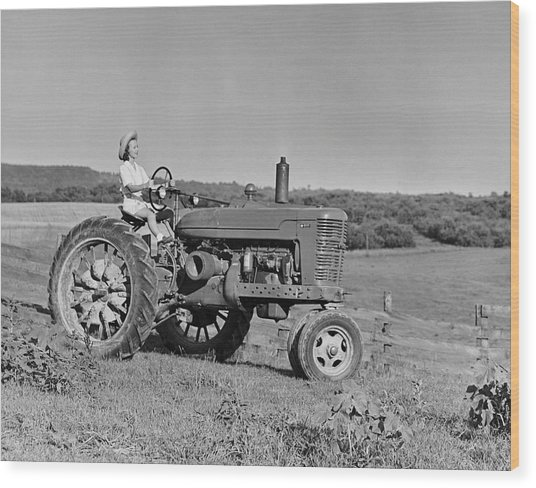 Woman Farmer Driving Tractor Wood Print by George Marks