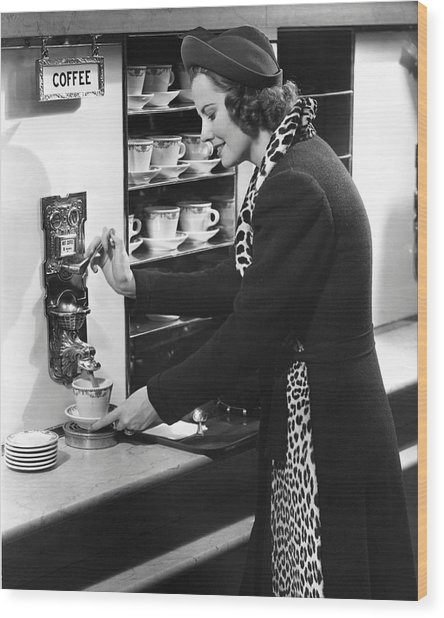 Woman Getting Coffee At Old Fashioned Machine Wood Print by George Marks
