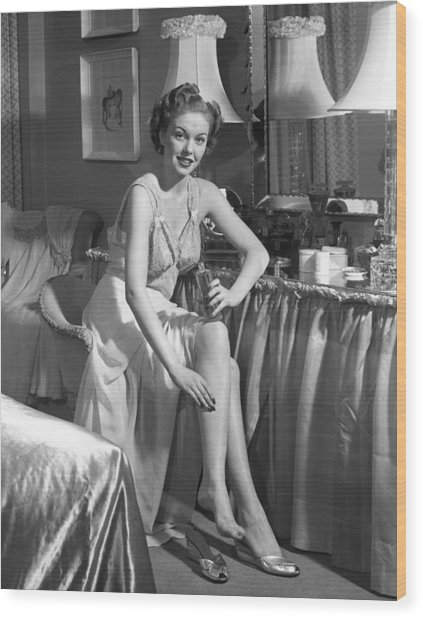 Woman In Bedroom Putting On Lotion Wood Print by George Marks