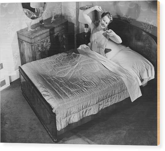 Woman Sitting In Bed Stretching Wood Print by George Marks