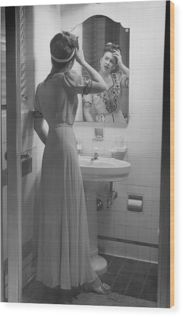 Woman Suffering Headache Standing In Front Of Bathroom Mirror, (b&w) Wood Print by George Marks