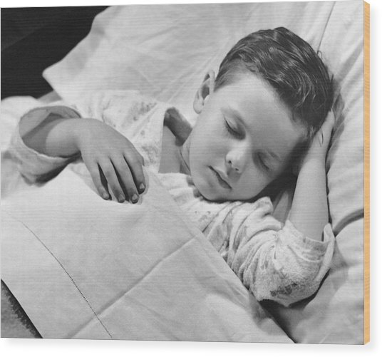 Young Boy Asleep In Bed Wood Print by George Marks