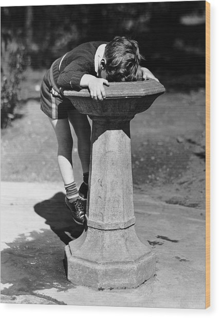 Young Boy Drinking From Water Fountain Wood Print by George Marks