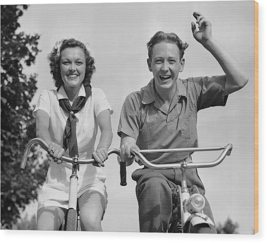 Young Couple Riding Bicycles Wood Print by George Marks
