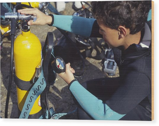 Young Scuba Diver Checking Kit Wood Print by Alexis Rosenfeld