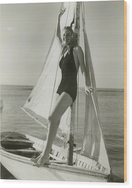 Young Woman Posing On Sailboat Wood Print by George Marks