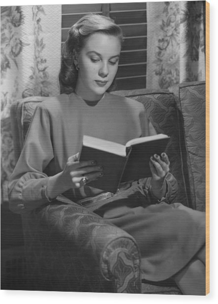 Young Woman Sitting On Sofa, Reading Book, (b&w) Wood Print by George Marks