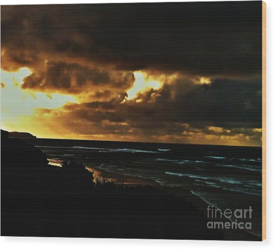 A Stormy Sunrise Wood Print