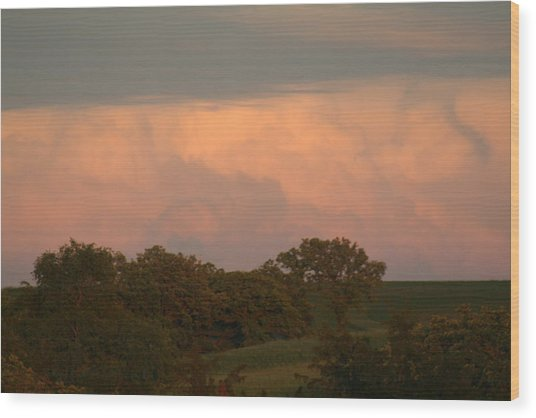 Clouds Of A Distant Storm Wood Print by Linda Ostby