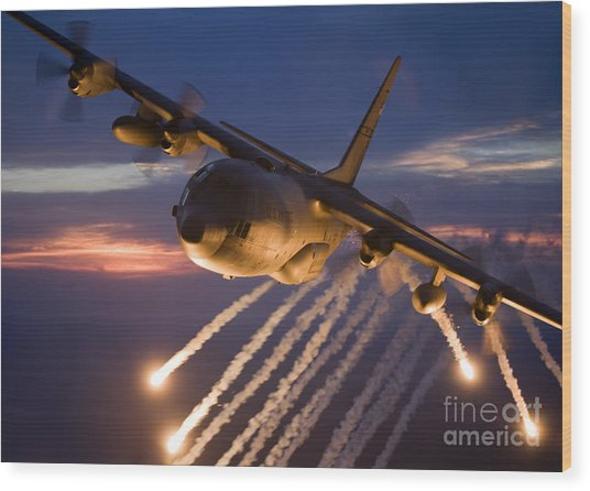 Wood Print featuring the photograph A C-130 Hercules Releases Flares by HIGH-G Productions