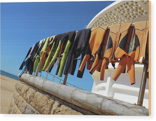 Drying Wet Suits Wood Print