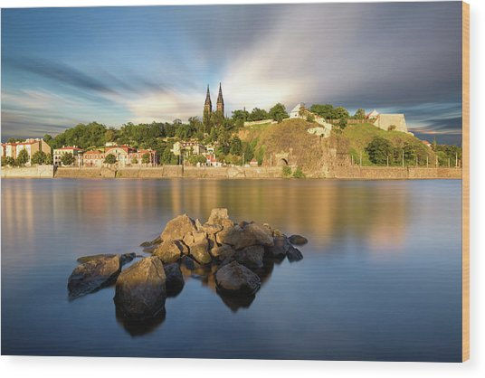 Famous Vysehrad Church During Sunny Day. Amazing Cloudy Sky In Motion. Vltava River, Prague, Czech Republic Wood Print