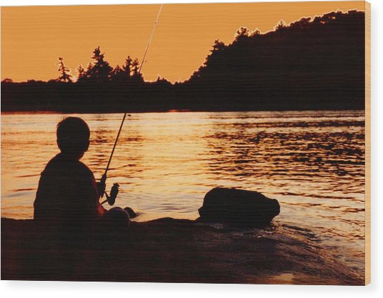 Fishing From A Rock  Wood Print