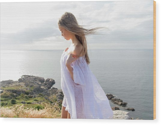 Girl In A White Dress By The Sea Wood Print