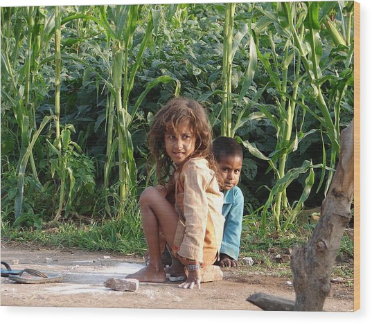 Girls In Her Own Field With Her Younger Brother Wood Print by Sandeep Khanwalkar