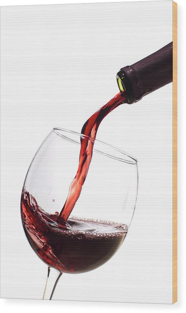 Red Wine Poured Into Wineglass Wood Print