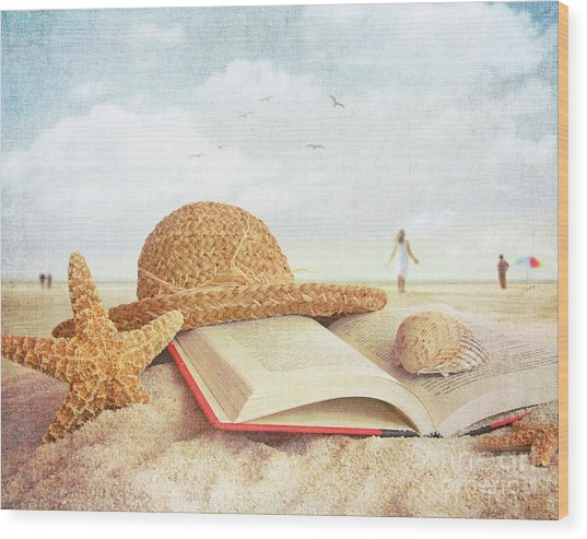 Straw Hat Book And Seashells In The Sand Wood Print