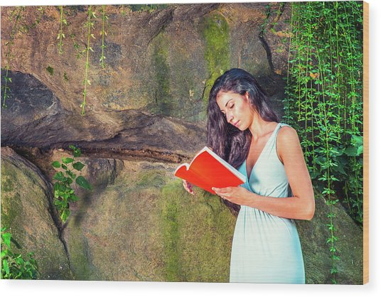 Young American Woman Reading Book At Central Park, New York, In  Wood Print