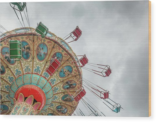 Swings In Motion With Stormy Sky Wood Print by Erin Cadigan