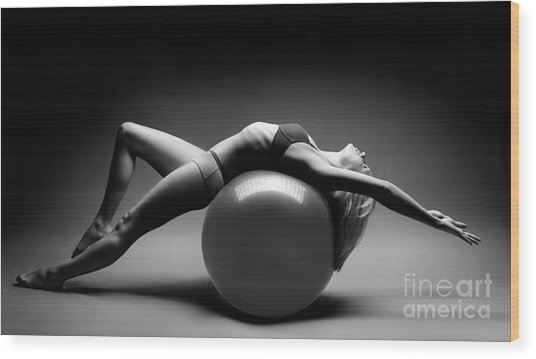 Woman On A Ball Wood Print