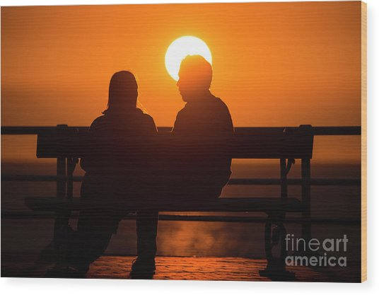 A Couple Sitting At Sunset Wood Print
