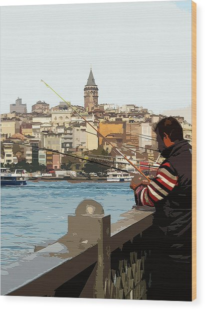 A Fisherman In Istanbul Wood Print