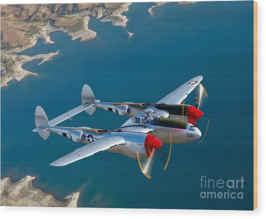 Wood Print featuring the photograph A Lockheed P-38 Lightning Fighter by Scott Germain