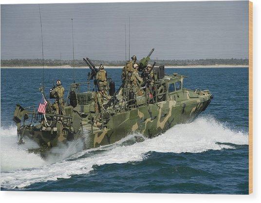 A Riverine Command Boat Conducts Wood Print