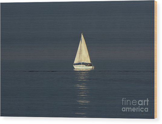 A Sailboat Capturing Light Wood Print