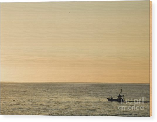 A Small Fishing Boat In Sunset Over Cardigan Bay Aberystwyth Ceredigion West Wales Wood Print