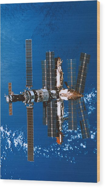 A Space Station Orbiting In Space Wood Print by Stockbyte