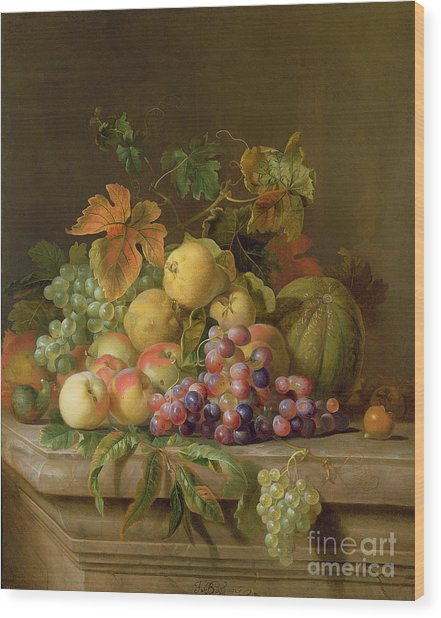 A Still Life Of Melons Grapes And Peaches On A Ledge Wood Print