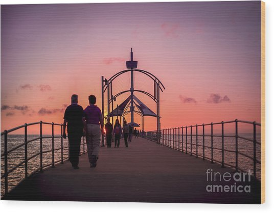 A Stroll Along Sunset Pier Wood Print