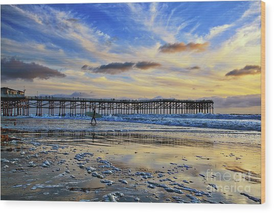 A Surfer Heads Home Under A Cloudy Sunset At Crystal Pier Wood Print