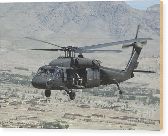 Wood Print featuring the photograph A Uh-60 Blackhawk Helicopter by Stocktrek Images