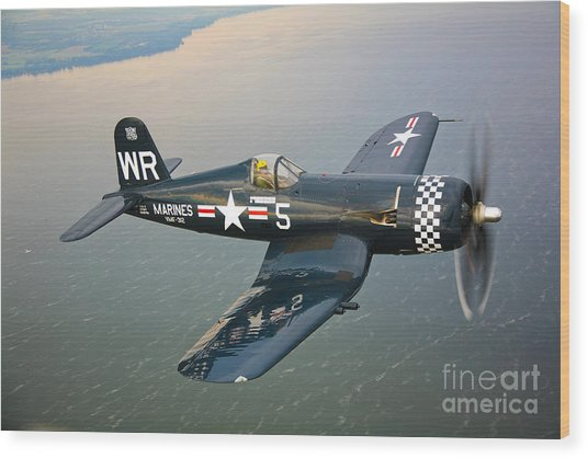 Wood Print featuring the photograph A Vought F4u-5 Corsair In Flight by Scott Germain
