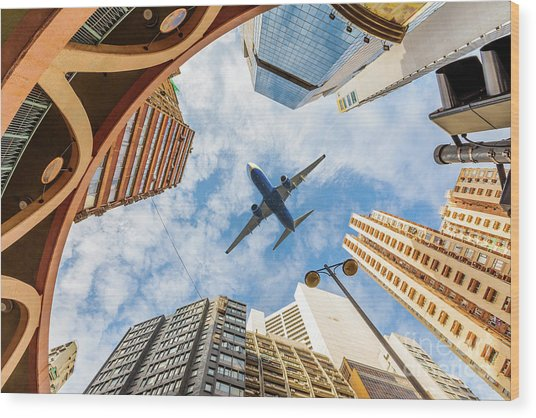 Airplane Above City Wood Print