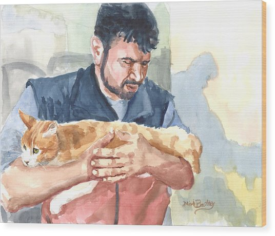 Alaa Rescuing An Injured Cat Wood Print