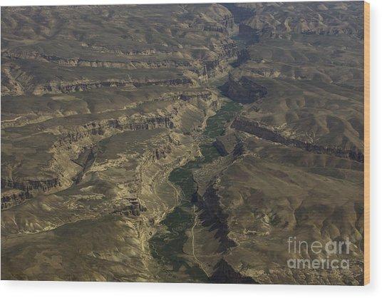 An Afghan Valley Wood Print by Tim Grams